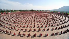 Everybody WAS kung fu fighting: Extraordinary moment 10,000 students put on a perfectly-synchronised show