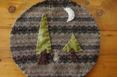 Wool trivet - Bunny in the evergreens by LittleWool on Etsy