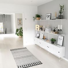 grey minimalistic rug, string pocket shelf, string shelves, string shelf living room, string shelves living room ideas for modern minimalist entrepreneurs String Shelf, Ikea Ps, Nordic Interior Design, Home And Living, Living Room, Scandinavian Interior, Room Interior, Interior Inspiration, Furniture Design