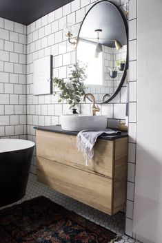 Wow This Modern Bathroom Reveal Is Absolutely Stunning What A Gorgeous Space Everything From The Black Tub And Shower Frame, The Champagne Bronze Faucets, And The Wood Vanity To The Black Ceiling And Built-In Storage Units What An Incredible Transform Bathroom Styling, Bathroom Interior Design, Home Interior, Decor Interior Design, Bathroom Storage, Bathroom Drawers, Vintage Farmhouse, Industrial Farmhouse, Industrial Bedroom