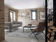 Modern Sofa Design Ideas from B&B Italia : Minimalist Grey Sofa in Rustoc Stone Walls Living Room with White Stand Lamp Stone Wall Living Room, Tiny Living Rooms, Sofa Design, Living Room Modern, Modern Sofa Designs, Stone Walls Interior, Home Decor, House Interior, Interior Wall Design
