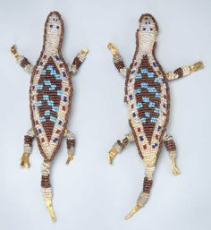 55170: A PAIR OF SIOUX BEADED HIDE UMBILICAL FETISHES c : Lot 55170