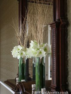 With yellow/gray vases, daises, and smaller, longer yellow flowers for centerpieces