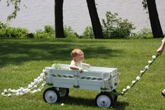 wagons for weddings flower girls | baby flower girl pulled in a decorated wagon. Green and white wedding ...