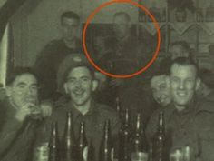 This photo dates back to WWII. It was taken in Egypt, while a few drinking buddies were having a happy gathering. Notice the transparent gentleman standing in the back. This was long before Photoshop! You be the judge.