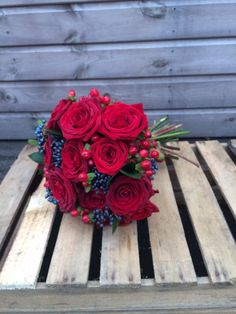 Red Naomi Roses, Viburnum and Hypericum Berries in a Hand tied bouquet for. Christmas Wedding