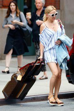 Kate Hudson wearing Christian Louboutin Paloma Tote Bag, Louis Vuitton Mon Monogram Pegase Suitcase, Aquatalia Heather Sandals and Surf Gypsy By Vintage Havana Stripe Textured Weave Romper