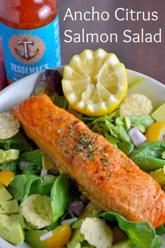 Ancho Citrus Salmon Salad Recipe- ancho chili salmon on spring greens with avocado, yellow tomato Parmesan crisps and southwest ranch dressing.