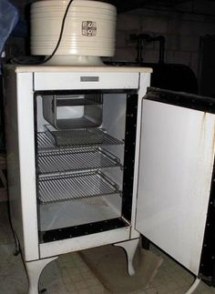 Antique electric refrigerator. Probably the number one energy waster in it's day.