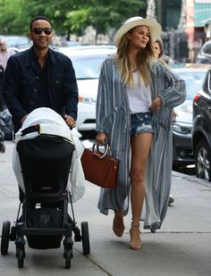 Chrissy Teigen and John Legend take a glamorous family day out in NYC.