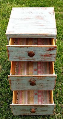 Distressed Dresser in Blue Chalk Paint, salvaged wood pulls and scrapbook paper draw lining. Photo 2 of 3.