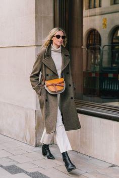 Le Fashion Blog London Fashion Week Classic Street Style Oval Sunglasses Wool Coat Cream Neutral Turtleneck White Straight Leg Jeans Black Leather Boots Via Collage Vintage