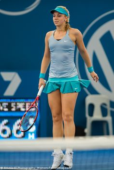 Jump, jump! Sabine Lisicki leaps into the air as one of her shots goes wide at the 2015 Brisbane International http://www.womenstennisblog.com/2015/01/05/thunderstorms-upsets-rock-brisbane-tuesday-gallery/