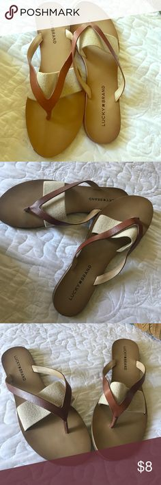 Lucky brand flip flop sandal Leather strap with metallic band across foot.  Excellent condition Lucky Brand Shoes Sandals