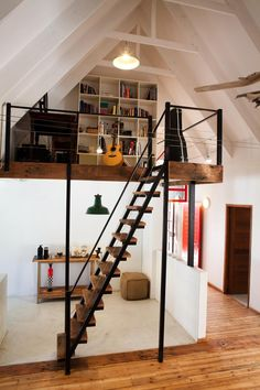 The mezzanine level makes the perfect study nook. Mezzanine Loft, Mezzanine Bedroom, Stairs In Living Room, House Stairs, Home Stairs Design, House Design, Modern Staircase, Spiral Staircases, House Extension Design