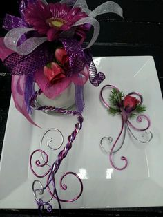 Our custom design serpentine arm  band corsage. With coordinating unique bout. Wire detail. Pink roses.