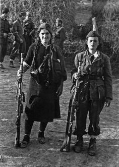 Women partisans belonging the Yugoslav 1st Proletarian Brigade pose with their Czech ZBvz 26 machine guns in the village of Zharkov near Belgrade on the eve of the battle for the Yugoslav capital, Oct 14, 1944.