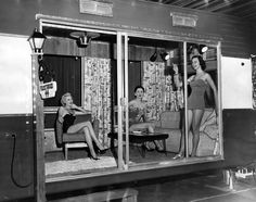 Models Connie James, Carol Brewster, and Dolores Berruezo show how glamorous it is to live in a 44-foot trailer home. The photo was taken in 1954 at the Trailer Life Show, held at the Shrine Exposition Hall.  (Bizarre Los Angeles)