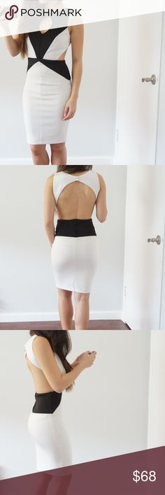 Black and white block dress With key hole, scuba material, backless, no bra necessary!! Frederick's of Hollywood Dresses Midi