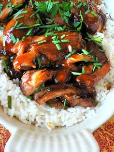 "Crockpot teriyaki chicken. // I think I left the chicken on ""Warm"" after it had finished cooking for too long because it was a little dry. But the sauce drizzled over it was amazing. Great flavor for the chicken to disguise the dryness and was great over the rice as well."