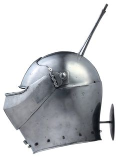 """A reconstruction of a rare Italian armet, in the style of circa 1450. Built on a helmet skull, possibly 16th or 17th century, the rear now extended to form a characteristic narrow plate over the nape, struck with a spurious armorer's mark and slotted for a crest, fitted with a brow plate with cusped inner-edge and in-turned lower edge, a pair of pivoted hinges carrying a blunt visor of """"sparrows' beak"""" type, a pair of large cheek-pieces hinged behind the visor pivots…"""