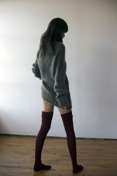 There's something sensual in this photo's simplicity: a patch of flesh between the baggy boyfriend sweater and sagging tights can be more enticing than someone in full get-up...