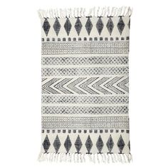 Check out this beautiful black and white carpet with Scandinavian print from the latest House Doctor collection. The pattern is hand block printed on the carpet.