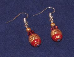 Tribal/Aztec red and gold drop earrings