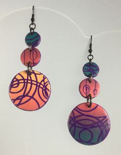 Polymer clay earrings by Annie Jacobi Jewelry. Skinner blend, long, circles, purple, pink