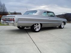 1964 Chevrolet Impala SS with Custom Cragars Mine was Azure Aqua - loved that car!!