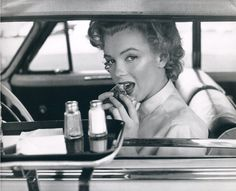 Marilyn Monroe with a burger. Hollywood, California, 1952