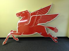"""Mobil Pegasus """"Flying Red Horse"""" Giant Porcelain Sign Sold For: $6,500.00. Bids: 22. Date: May 17, 2012."""