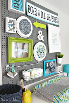 IHeart Organizing: Reader Space: Sweet Baby Storage --- Love this dark grey painted pegboard to have an 'organised' area for items that could otherwise be cluttered around the room.. will also transition nicely as child grows to display artwork, homework, etc =)