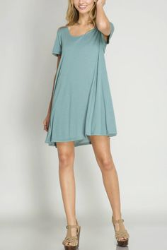 Swing dress tunic that can be worn with or without pants/leggings. It has a short cap sleeve with a back lace -up detail. Hand wash in cold water separately no bleach hang to dry. Swing Dress Tunic by She  Sky. Clothing - Tops - Tunics Iowa