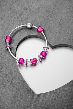 The iconic PANDORA heart is updated with a new expression thanks to the addition of a glossy violet enamel finish. Reminiscent of the shiny foil-wrapped chocolate hearts given on Valentine's Day, this sweet design will last much longer, and is sure to be a treasured keepsake of the most romantic day of the year. #PANDORAbracelet #PANDORAcharm