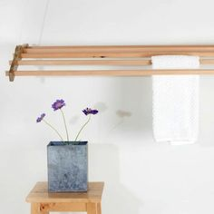 Drying rack that suspends from the ceiling through a pulley system. Easily lower the rack to put clothes on it and raise it up to save space when done. With removable tubes, it can hold an entire load of laundry and fit into nearly any space.