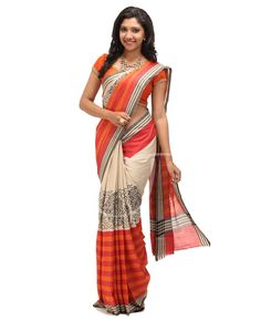 Soft Jute Fabric. Multicolor. Body is Half n half, beige with black printed designs, other half is of red n orange horizontal lines with border. Border is Black n beige horizontal lines. Red n orange vertical lines pallu with border. Blouse is Red with saree border.