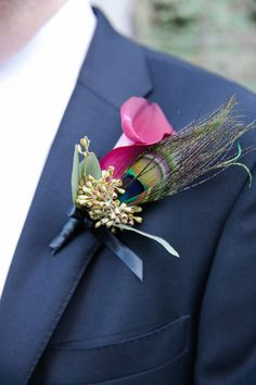 Greg and Michael each wore deep red #rose boutonnieres on their #wedding day to match their wedding color #palette | Photos by Kelly Guenther Photography