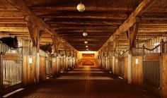 Beautiful completely wooden horse stalls and barn
