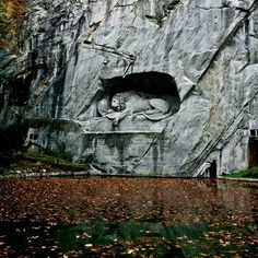 The Lion Monument in Lucerne, Switzerland is a giant dying lion carved out of a wall of sandstone rock above a pond at the east end of the medieval town. It was designed as a memorial for the mercenary soldiers from central Switzerland who lost their lives while serving the French king Louis XVI during the French Revolution.
