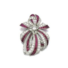 Ruby and diamond brooch, 1950s Of ribbon bow design, set with calibré-cut rubies and brilliant-, single-cut and lozenge-shaped diamonds, fitted case.