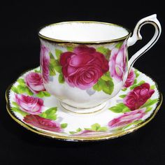 Offering one beautiful Royal Albert Old English Rose Tea Cup and Saucer Alternating one dark, two light large pink roses, pretty Hampton Shape Gold trim is frosted along the edges Handle has gold trim curling down along the sides following the curve of the handle One gold stroke on tip