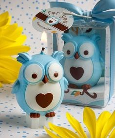 Blue scented candle with brown and white details in the shape of a cute-as-can-be, wide-eyed owl with a great big heart A natural fit as favors for Christenings, first birthdays or for any baby boy occasion