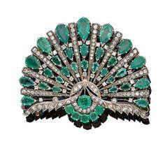 An emerald and diamond brooch