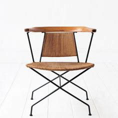 A stunning chair designed Arthur Umanoff, this style is very rare. Paper cord seat + back on wrought iron bases with wrap around wood armrest.