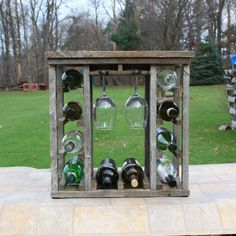 You are viewing a handmade Tabletop 10 Bottle Rustic Pennsylvania Barn Wood Wine Rack with 6 Wine Glass Rack. * 100% Handmade Wine Rack. * 100 + year old re-purposed Pennsylvania barn wood. * Unfinished. * Rustic or primitive look. * Top shelf for display or additional storage. * Very