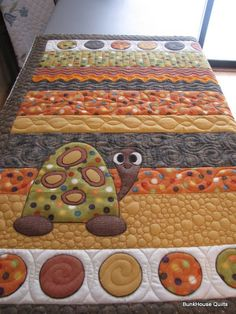 LOVE LOVE LOVE! Like the applique of the turtle AFTER quilting...wait...how would that work?...so maybe not done after, just not quilted over...
