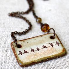 idea from birds on a wire- ceramic necklace do it in glass for sculpture piece