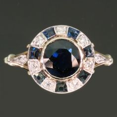 Art Deco Ring with Blue Sapphires and Diamonds.
