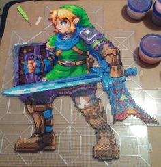 """Hyrule Warriors - Link Perler WIP 3 (The finished piece is about 8400 beads and around 27"""" x 24"""") - By kamikazekeeg on deviantART"""